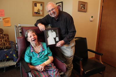 Charles Luman visits his wife, Libby, several times a week at a nursing home in Maplewood. Luman holds the couple's wedding photo on a recent visit. (Photo by Kristal Leebrick)