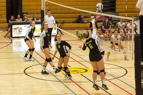 Como Park Cougars compete against the Washington Eagles on Sept. 4. Como players pictured from left are Elianna Wiersma, Jenna Krivit, Rachel Love and Bekah Hausman. (Photo by Mike Krivit)