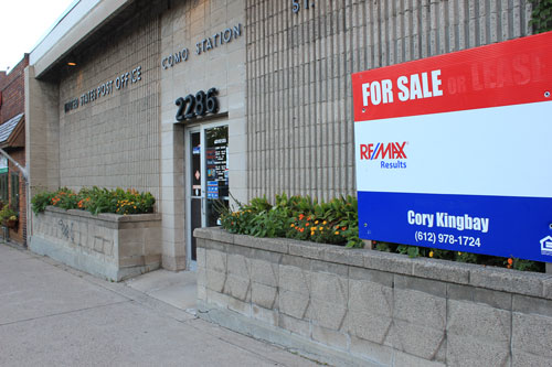 The for sale sign in front of the Como Station post office is not a welcome sight for many area residents.