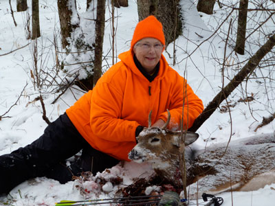 Elaine Phillips and the buck she bagged three months after her 80th birthday. Photo courtesy of Dick Phillips