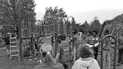 Volunteers help construct the new playground at Curtiss Field