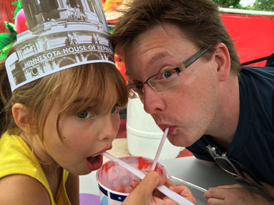 Alex Lodner's daughter and husband, Millie and Tony Huth, drinking a cherry float at the 2014 Minnesota State Fair. Photo by Alex Lodner