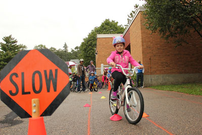 First-grader Ayla Bornsztein takes her turn on the skills track at the St. Anthony Park Elementary School Bike Rodeo Sept. 18.