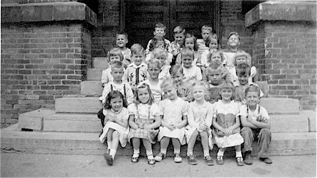 A kindergarten class in spring 1951. The writer is in the third row, second from left.