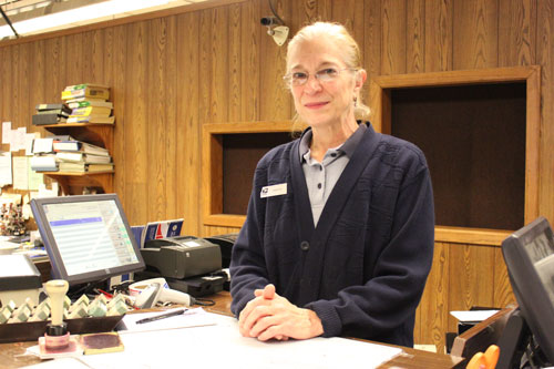 Annette Edeburn has been working at the post office on Como Avenue for nearly 30 years.