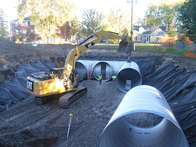 Installation of the piping system under Curtiss Field. Photo courtesy of Capitol Region Watershed District