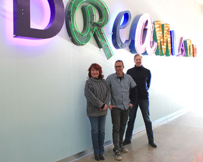 This neon Dreamland sign decorates the wall just outside the entry to IFP MN, one of the anchor tenants at Vandalia Tower. Pictured here are IFP's Nancy Paul, development director; Deacon Warner, youth programs director; and Reilly Tillman, deputy director and education director. Photo by Kristal Leebrick