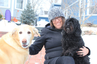 Guardian ad litem Sunny Comstock and her dogs Bo and Smidge. Photo by Kristal Leebrick