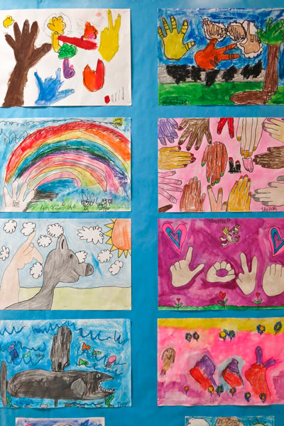 An art project created by Metro Deaf School elementary students merges images and American Sign Language (ASL) signs. Photo by Lori Hamilton