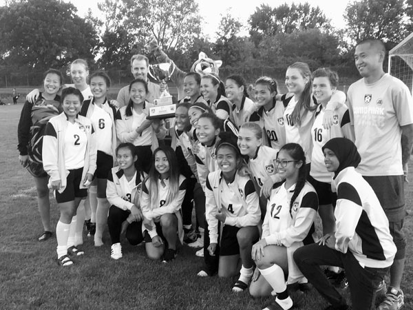 The popularity of soccer in St. Paul is peaking with huge participation numbers in the schools and the anticipation of Major League Soccer. The inaugural Mayor's Cup soccer matches were held at Como Park High School on Sept. 16. The Como girls display their trophy.