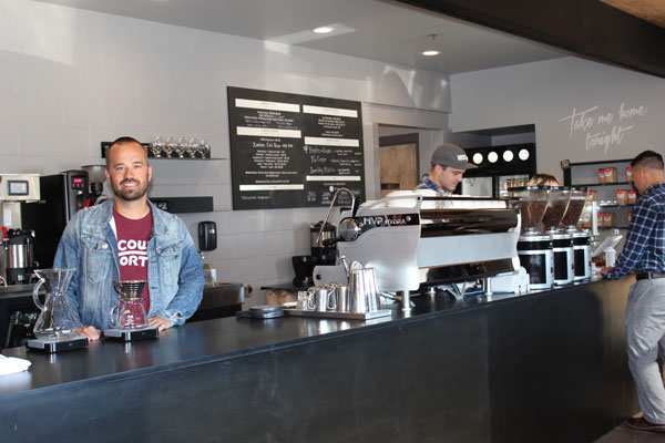Dan Anderson stands behind the counter at Dogwood Coffee, 825 Carleton St., St. Paul. Photo by Kristal Leebrick