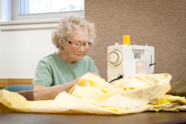 Eleanor Gorden works at a sewing machine. Photos by Lori Hamilton
