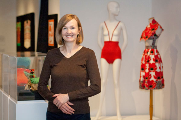 Goldstein Museum associate curator Jean McElvain drew up the initial list of items to choose among for the 40th anniversary exhibit. McElvain stands before the Rudy Gernrich monokini. Photo by Lori Hamilton