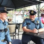 St. Paul police officers Shannon Diedrich and Randy Axtell take time to chat outside the Finnish Bistro recently. Photo by Kristal Leebrick