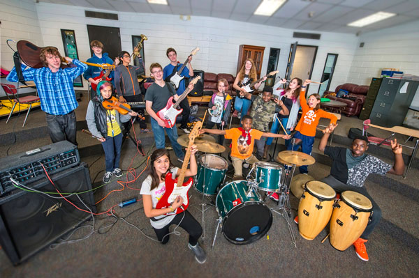 Andy Rockwood, far left, and Jeremy Barta (not pictured) lead the Murray Rock Band twice a week after school. Photo by Mike Krivit