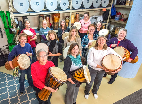 """Drumming builds confidence and happiness,"" says drum teacher Bettie Seitzer, shown here with her Tuesday night class. Photo by Mike Krivit"